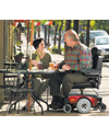 Invacare® Pronto® M51™ Power Wheelchair with Office Style Seat - shown in use