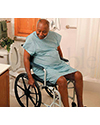 Invacare® Mariner Rehab Shower Wheelchair with Commode - shown in use over toilet