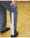 Maddak Extra Long Coated Metal Shoehorn and Sock Remover - Shown in use